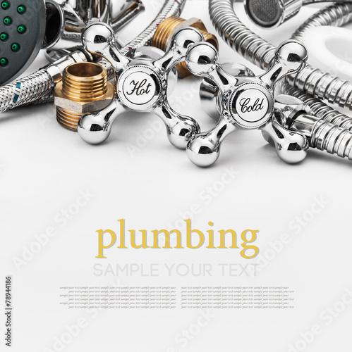 Leinwanddruck Bild plumbing and tools on a light background
