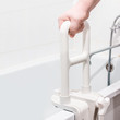 hand holding the handrail in the bathroom - 78944558