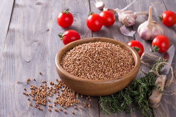 Buckwheat in a bowl with tomato, garlic and thyme