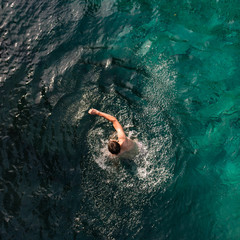 aerial view of man swimming front crawl