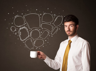 Businessman holding a white cup with speech bubbles