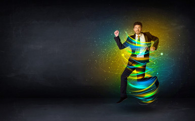 Excited business man jumping with energy colourful lines