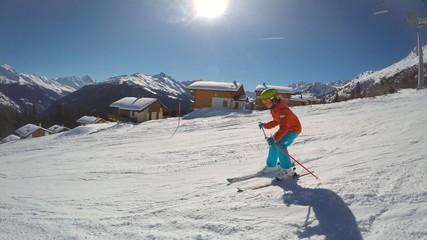 Skiing - young girl skiing down