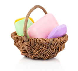 colorful soap bars in the wicker basket, Isolated on white backg