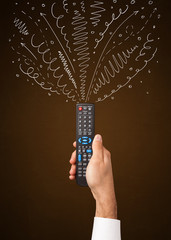 Hand with remote control and curly lines
