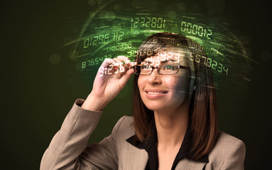 Business woman looking at high tech number calculations