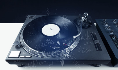 Turntable playing music with hand drawn cross lines
