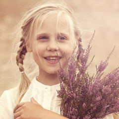 Young girl with heather flowers