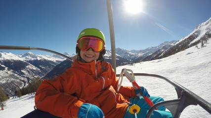 Skiing - young girl on ski lift