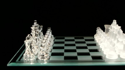 4K. Glass chess board with figures on black background