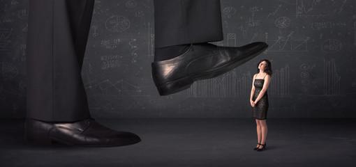 Huge leg stepping on a tiny businnesswoman concept