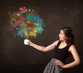 Businesswoman holding a white cup with diagrams and graphs