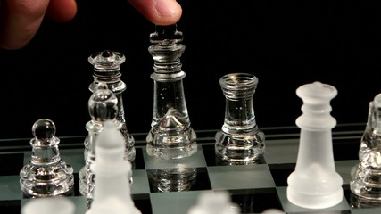 4K. Falling pieces on the chessboard, black background
