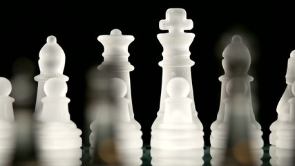 4K. Glass chess dynamic change of focus. Hand transposes pawns