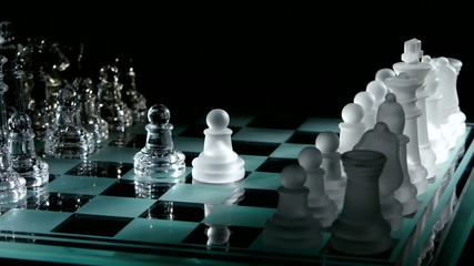 4K. Beautiful pieces on the chessboard. black background.