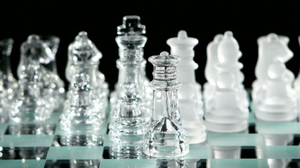 4K. Beautiful glass chess, black background. figures move on the