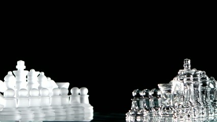4K. White and glass chess is standing on board