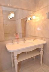 Bathroom interior fragment in light tones