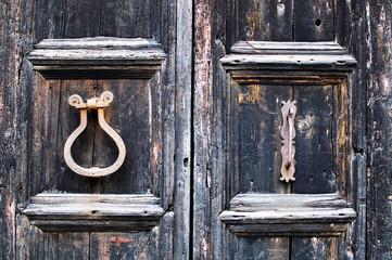 old door with rusty iron handles