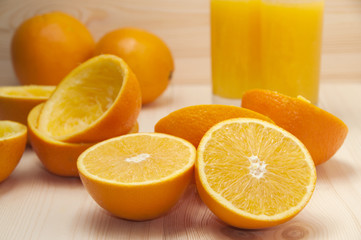 Orange slices for squeezing and fresh orange juice