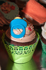 Cupcake with colorful figures made of fondant