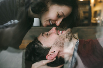 Vintage couple . Girl kiss her boyfriend from above  .Coffee sho