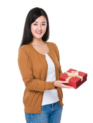 Woman hold a red gift box