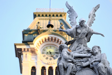 DETAIL OF STATUES IN uNITà SQUARE WITH TRIESTE TOWN HALL IN THE