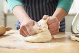 Close Up Of Hands Kneading Dough