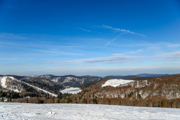 snow skiing landscape of mountains in Vosges, France