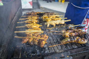 street food grilled barbeque fish pork chicken concept