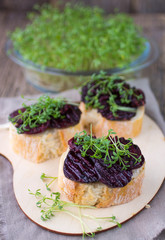 Bruschetta with roasted beet and watercress salad
