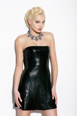 Elegant Blond Woman in Black Leather Dress