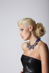 Profile of Young Contemplating Blonde with Necklace