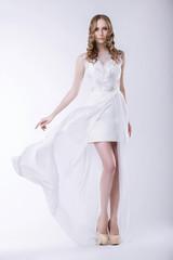 Elegance. Gorgeous Bride in Luxurious Dress