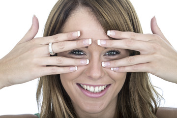 Happy Young Woman Peering Through Fingers