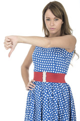 Sad Young Woman Wearing Blue Polka Dot Dress Thumbs down