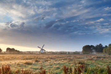 Dutch windmill and beautiful sunrise sky