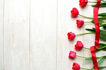 Red tulips with ribbon
