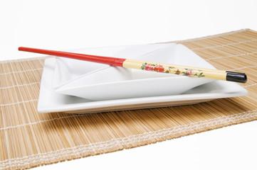 chopsticks on angular dish parallel