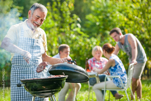 Family having a barbecue party - 78963123