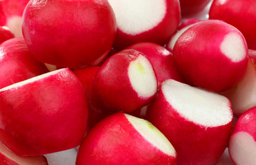 background of prepared red radishes