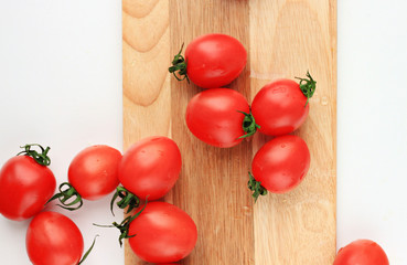 tomatoes cherry on wooden white background