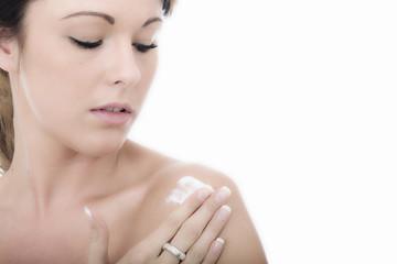 Attractive Young Woman Applying Moisturizing Cream