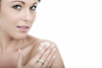 Attractive Young Woman Applying Moisturizing Cream
