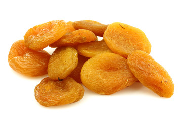 colorful dried apricots on a white background