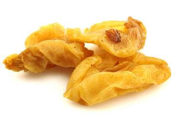 dried pear halves on a white background