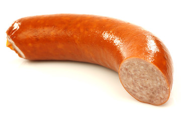 a piece of smoked sausage on a white background