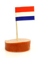 a piece of smoked sausage with a Dutch flag toothpick
