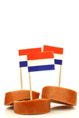 pieces of smoked sausage with Dutch flag toothpicks